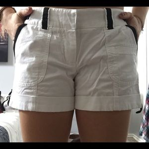 White Cashé shorts with black detailing